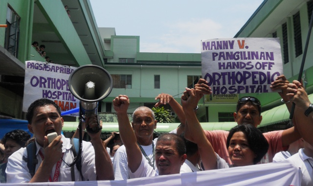 "Health workers and employees of the Philippine Orthopedic Center walk out during lunch break as protest against the hospital's looming ""modernization."" (Photo by  Anne Marxze D. Umil/ bulatlat.com)"