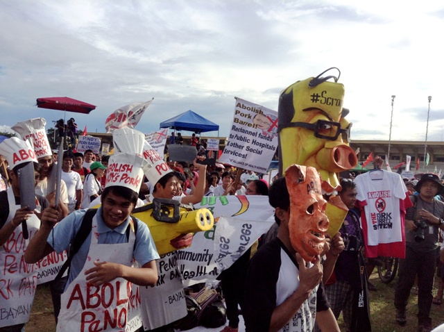 Protesters demand the scrapping of entire pork barrel system, including Noy's biggest pork, to re-channel all discretionary funds directly to services. (Photo by M. Salamat / )