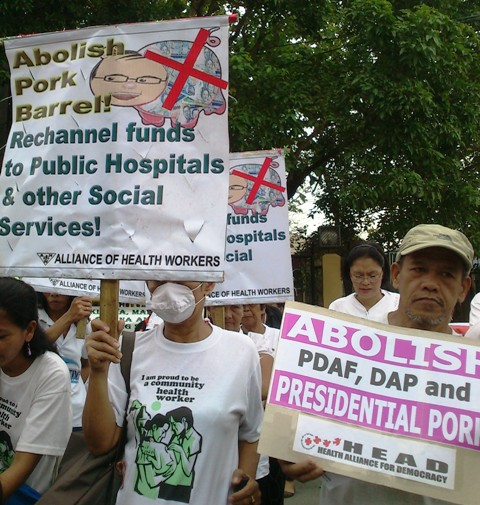 Patients and health workers protest in front of the Senate against pork barrel. (Photo by Anne Marxze D. Umil/Bulatlat.com)