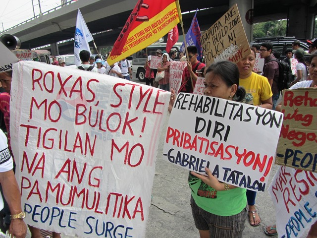 In a protest in front of DILG office, members of People Surge deplore the actions of Sec. Mar Roxas and warn the public against his presidential ambition. (Photo by M. Salamat / bulatlat.com)