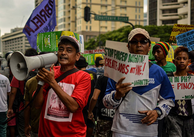 Members hold a protest action against the ongoing World Economic Forum, May 21. (Photo by Loi Manalansan / Bulatlat.com)