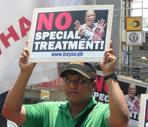 Groups rally against special treatment for alleged plunderers