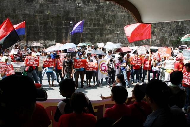 NXP workers hold picket in front of headquarters of Labor Dept in Manila June 16. (Photo courtesy of KMU  Public Info Dept.)