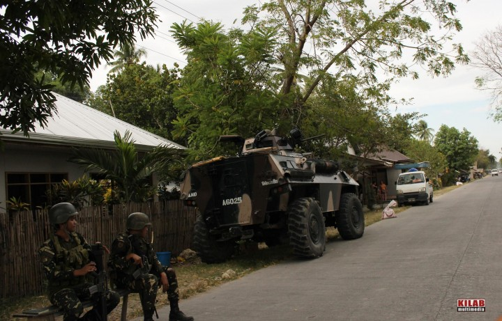 Soldiers and armored personnel carrier posted in Dapyawan village, Datu Saudi Ampatuan, Maguindanao (FILE PHOTO by Kilab Multimedia)
