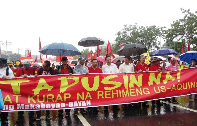 Protesters brave heavy downpour, defy security barriers to deliver 'real SONA'