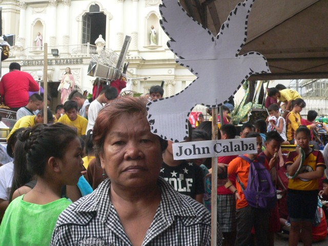 "Ligaya Portajada, whose husband Armando was disappeared in 1987, holds a ""dove"" for the latest missing victim (Photo by D.Ayroso/Bulatlat.com)"
