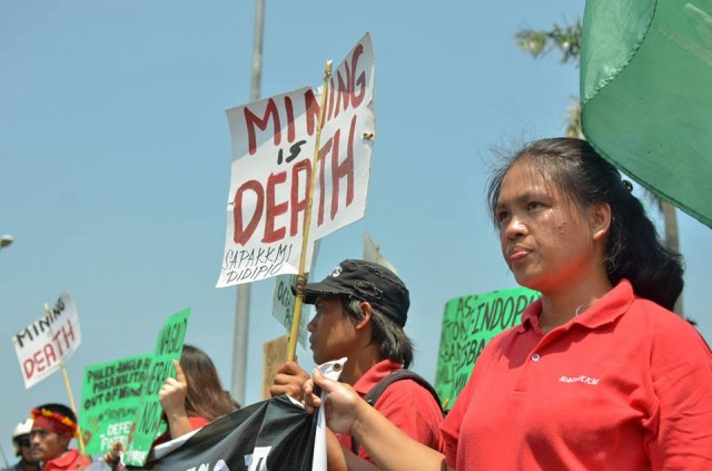 A protester from Didipio, Nueva Vizcaya where mining operations by OceanaGold and FCF Minerals had polluted the rivers (Photo by Kalikasan PNE/Bulatlat.com)