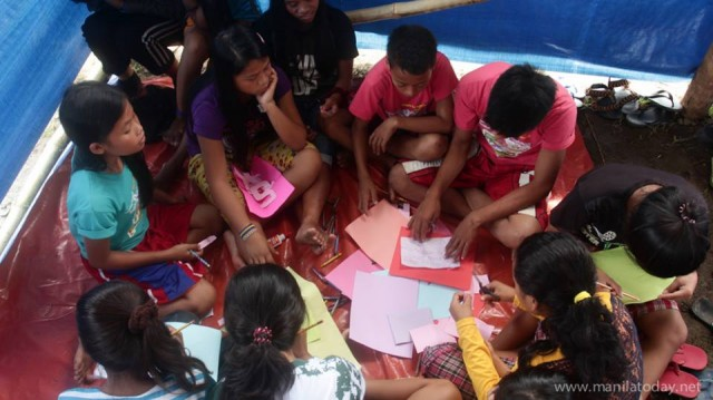 Students in trauma relief sessions at the evacuation center in Tandag City Photo courtesy of Manila Today)