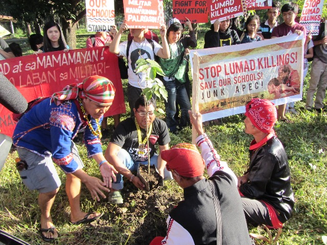 Bulatlat picture: Manilakbayan plants tree for UP