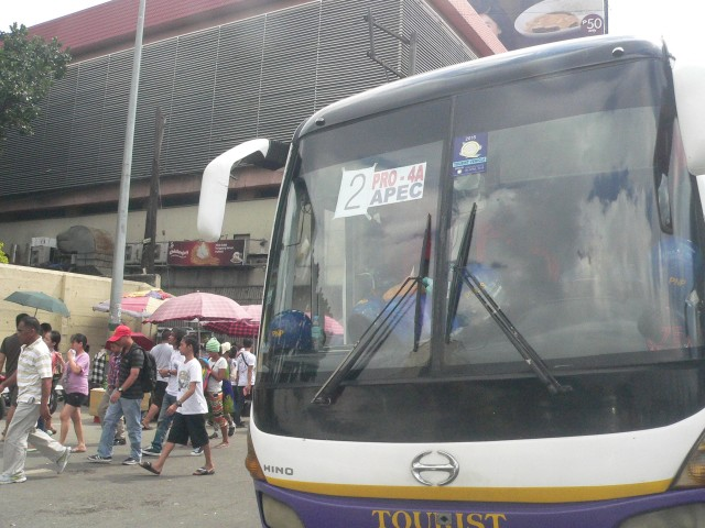 One of the buses outside the Baclaran church compound, with police men resting inside (Photo by D. Ayroso/Bulatlat.com)