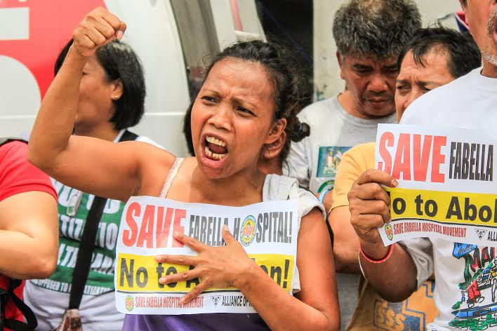 Lucinda Tayao joins the protest on June 8 to oppose the demolition of the public hospital.  (Photo by K.A.Macalalad/Bulatlat)