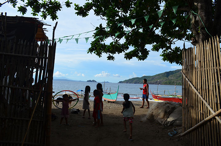 Children playing along the shores of Patungan Cove is a common sight in the coastal barangay Sta Mercedes in Maragondon, Cavite. The cove faces the famous Corregidor and Carabao Islands of Bataan province in the south. (Photo by Jen Guste / Bulatlat)
