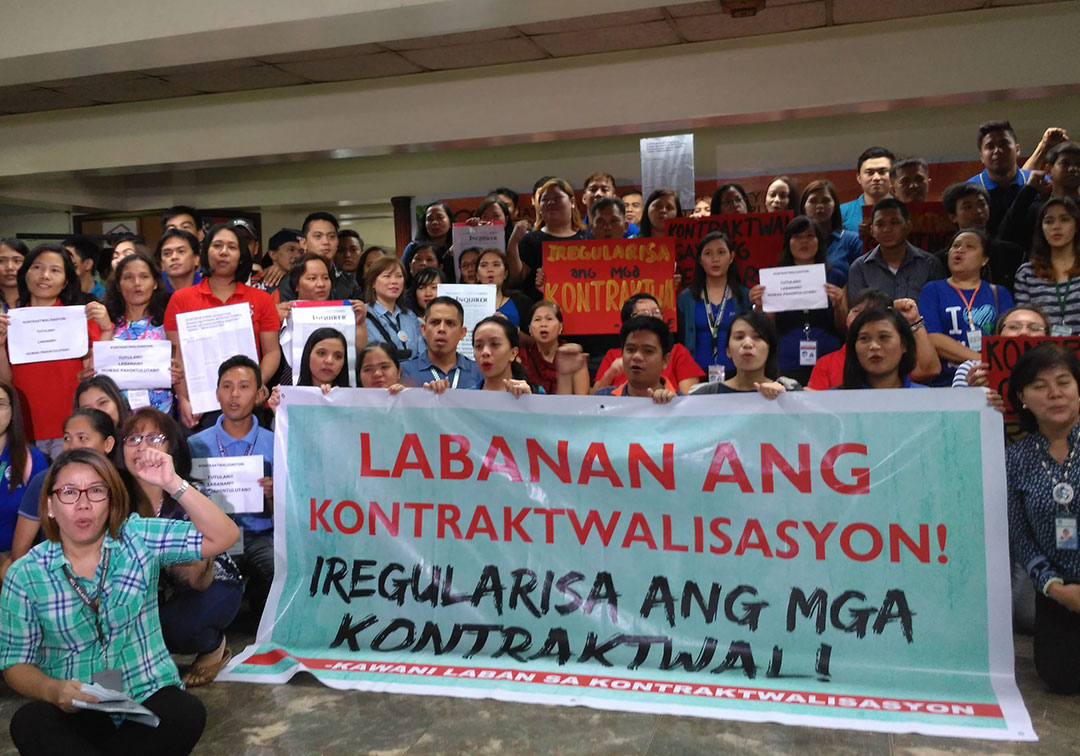 Contractual employees of the National Housing Authority (NHA) demand job security, benefits. (Photo by Ronalyn V. Olea / Bulatlat)