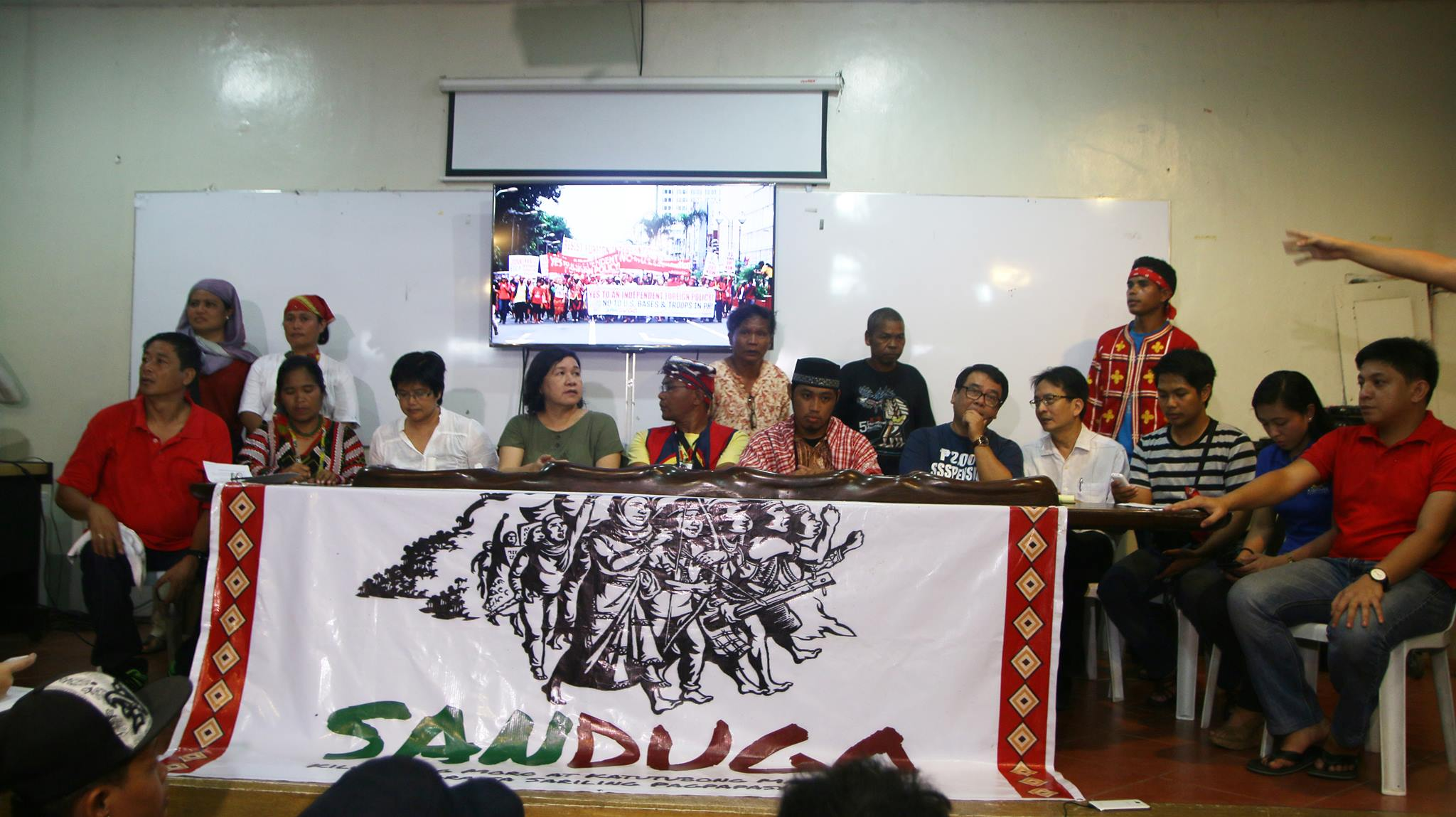 Sandugo convenors along with sectoral leaders and advocates, at a press conference at the College of Fine Arts in UP Diliman on Oct. 20. (Photo by Divine Miranda/Kodao Productions)