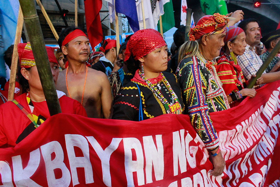 "Indigenous peoples in the Philippines demand the repeal of anti-indigenous peoples laws in a protest caravan dubbed ""Lakbayan (Journey) of National Minorities for Self Determination and Just Peace."" (Photo by Ken Bautista)"