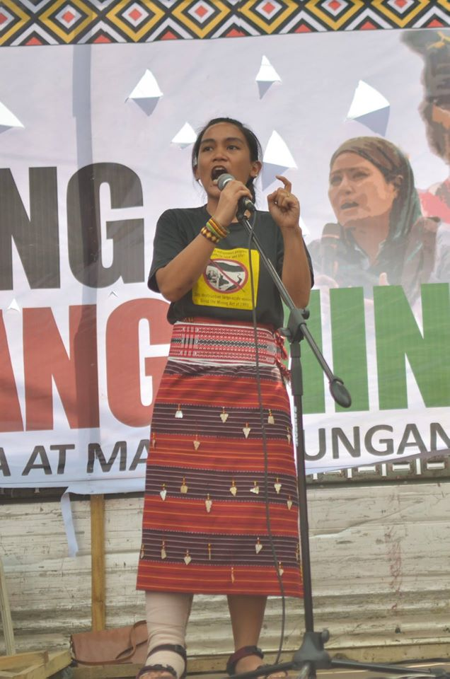 UNWAVERING. Piya Macliing Malayao at the Lakbayan closing rally in Mendiola Oct. 21. Her right leg is in a gutter cast after being run over by a police mobile run amok in the Oct. 19 US embassy dispersal. (Photo by Carlo Manalansan/Bulatlat)