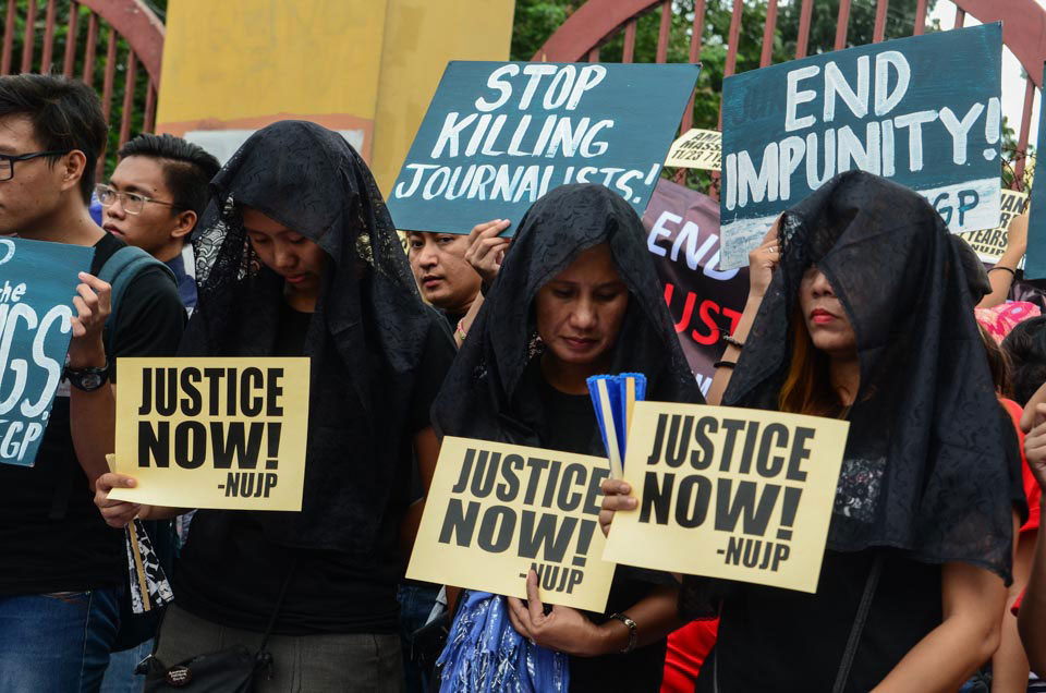 Widows of the Ampatuan Massacre victims join a protest action in Manila. (Photo by Raymond Panaligan)