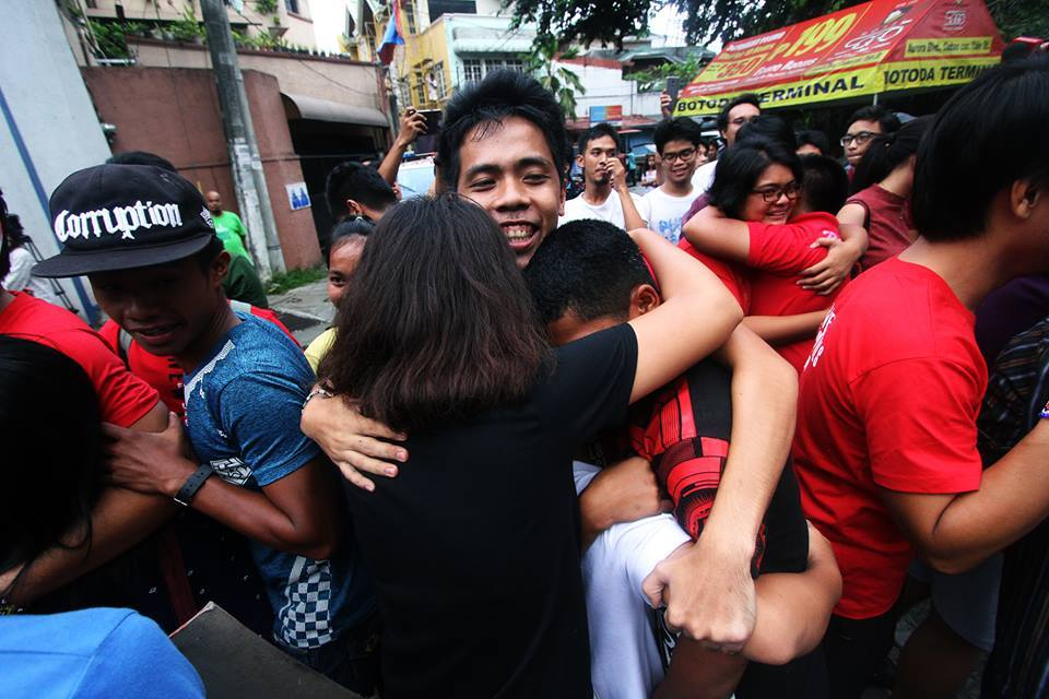 Lumad students greet Chad Booc as he and the seven other youths were released from Camp Caringal on July 25. (Photo courtesy of Alcadev Inc.)