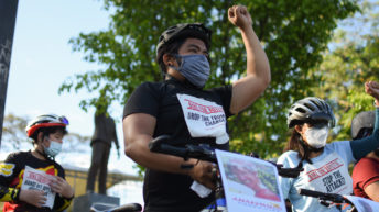 Activists hold bike ride in support of red-tagged Bayan officer, Dutch missionary